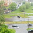 Постер, плакат: Above view of urban street in pouring rain