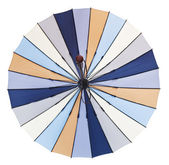 Rear view of open striped multicolored umbrella — Stock Photo