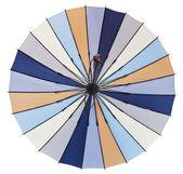 Vista di ombrello multicolore a strisce aperto posteriore — Foto Stock