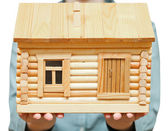 Wooden house on palms — Stock Photo