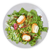 Top view of green salad with goat cheese on plate — Foto de Stock