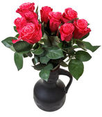 Bouquet of red roses in black ceramic jug — Stock Photo