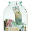 Get out saving euro money from glass jar — Stock Photo #48416955