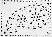 Perforated paisley figure on white leather — Zdjęcie stockowe