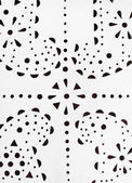 Punched paisley ornament on white leather — Stok fotoğraf