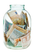 Keeping euro money in glass jar — Stock Photo