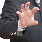 Businessman shows attacking palm close up — Stock Photo