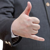 Businessman shows phone call sign - hand gesture — Stock Photo