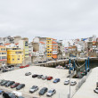 Urban port and car parking in town Malpica — Stock Photo