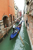 Ourists floating in gondola in canal in Venice — Stock Photo