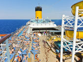 Sunbathing on the deck of cruise liner — Stock Photo