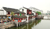 Retail pavilions on waterfront in China — Stock Photo