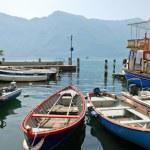 Boats near pier in town limone sul garda — Stock Photo #50350741