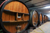Oak wine barrels in a wine cellar — Stock Photo