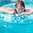 Girl in swim goggle on inflatable circle — Stock Photo #51414751