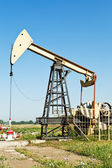 View of pumpjack pumping oil — Stock Photo