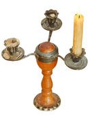 Triple candlesholder with one lighted candle — Stock Photo