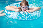 Girl in swim goggle on inflatable circle — Stock Photo