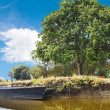 Wooden boat in lake, France — Stock Photo #51533881