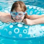Girl in swim goggle on swimming circle — Stock Photo #51534629