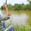 Fisherman fished out small rudd fish — Stock Photo #51534707