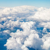 Clouds in blue sky and earht under clouds — Stock Photo