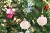 Pink balls and house christmas decoration — Stock Photo