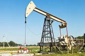 Pumpjack pumps oil in Kuban region, Russia — Stock Photo