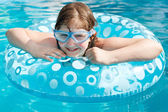 Girl in swim goggle on swimming circle — Stock Photo