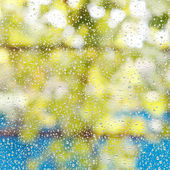 Rain drops on window glass after summer shower — Stock Photo