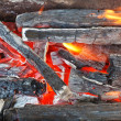 Flame over burning wood-burning coals — Stock Photo #51652215