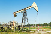 Oil extraction by pumpjack in Caucasus region — Stock Photo