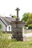 Old stone cross in village de Breca, France — Stock Photo
