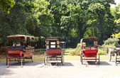 Old carriages in village, France — Stock Photo