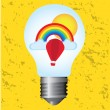 Light bulb with rainbow — Stock Vector