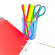 Glass with office supplies and notebook — Stock Photo