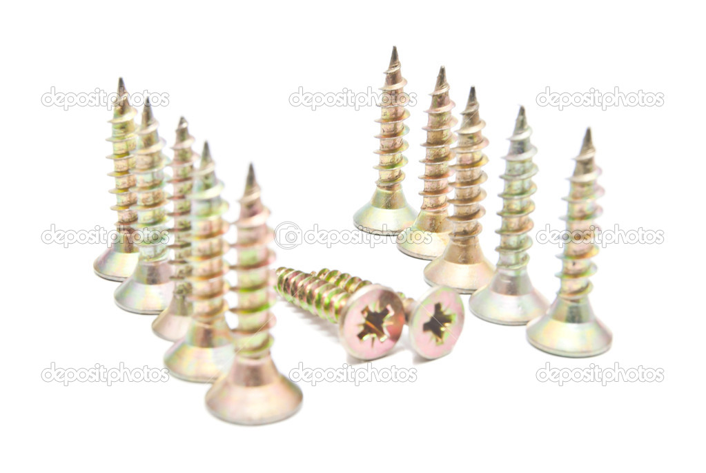 Many golden screws on white background — Stock Photo #12473920