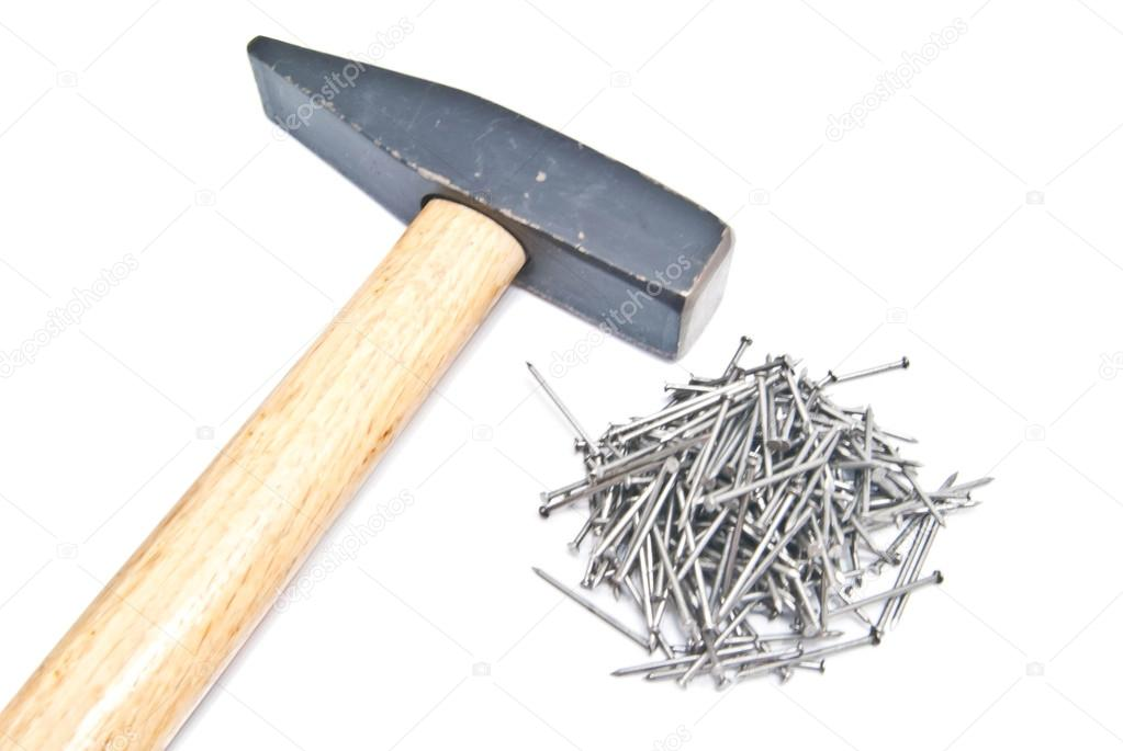 Set of silver nails and hammer on white  Stock Photo #12474037