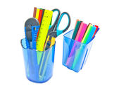 Blue glasses with office supplies on white — Stock Photo