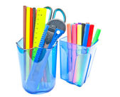 Two glasses with office supplies — Stock Photo
