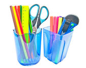 Blue containers with office supplies close-up on white — Stock Photo