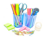 Two containers with office supplies close-up on white — Stock Photo