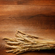 Royalty-Free Stock Photo: Wheat on the wood background