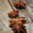 Star anise was placed on top of the wooden board - Stock Photo