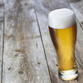 Glass beer on wood background with copyspace — Stock Photo