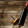 Wine Bottle on a wooden background — Stock Photo