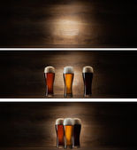 Tree glass beer on wood background with copyspace — Stock Photo