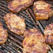 Escalope on grill - Stock Photo