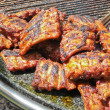 Spareribs on grill - Stock Photo
