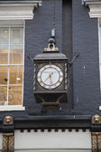 An Old English Street Clock — Stock Photo